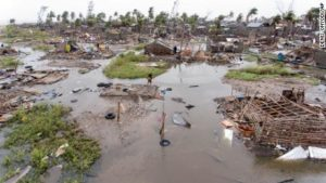 Image from CNN.com - In this photo taken on Friday, March 15, 2019 and provided by the International Red Cross, an aerial view of the destruction of homes after Tropical Cyclone Idai, in Beira, Mozambique. Mozambique's President Filipe Nyusi says that more than 1,000 may have by killed by Cyclone Idai, which many say is the worst in more than 20 years. Speaking to state Radio Mozambique, Nyusi said Monday, March 18 that although the official death count is currently 84, he believes the toll will be more than 1,000. (Denis Onyodi/IFRC via AP)